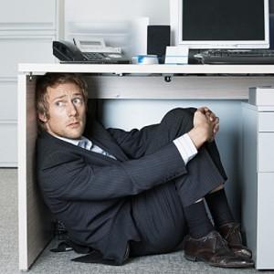 Fear-man-under-desk